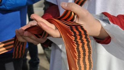 В течение двух недель по всему региону разлетятся более 100 тысяч черно-оранжевых лент